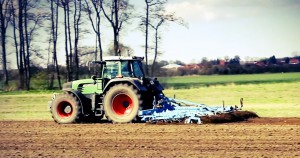 Tractor operating on land