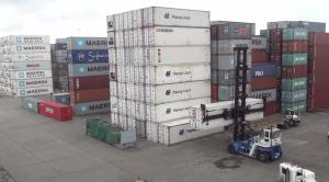 Container forklift operating at a harbor