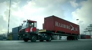 terminal tractor carrying a container