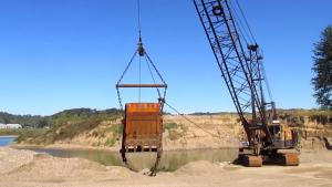Lattice boom crawler crane at work  at a river