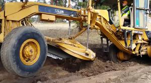 Grader working inclined surface