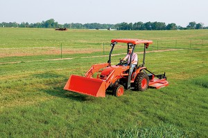 KUBOTA B26 Tractor mowing the grass