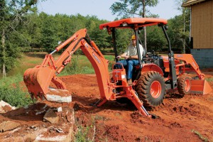 KUBOTA B26 backhoe tractor working the garden